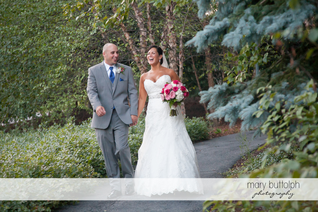 Couple walk in the garden at The Lodge at Welch Allyn Wedding