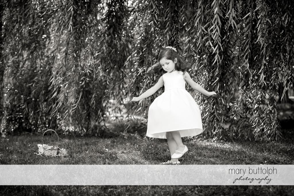 Bride's niece plays in the garden at Syracuse Wedding