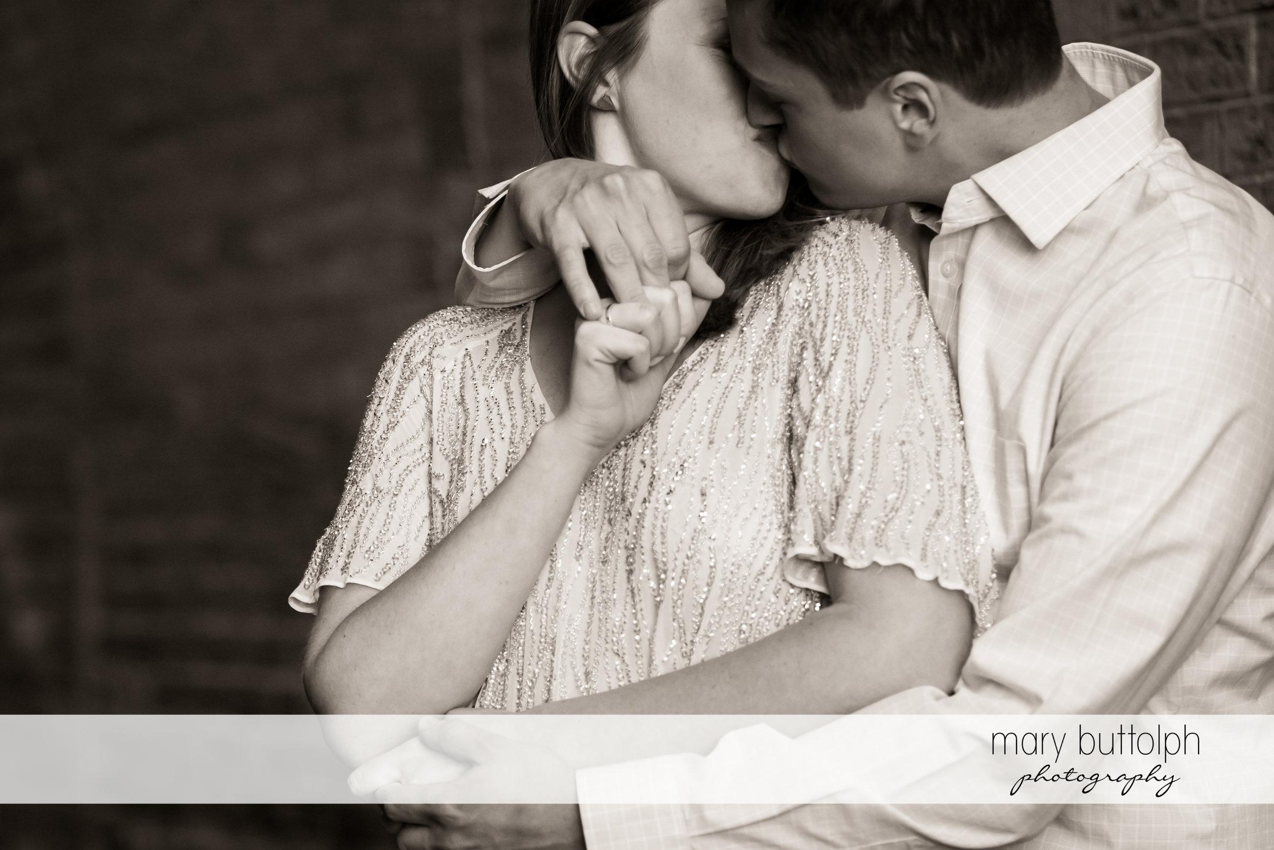 Couple kiss at Skaneateles Engagement