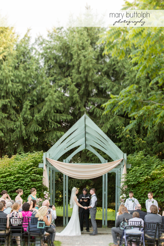 Couple in garden wedding with guests at John Joseph Inn and Elizabeth Restaurant Wedding