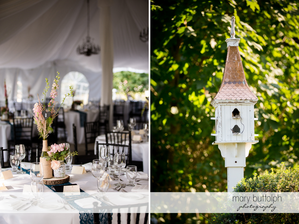 Flowers adorn the tables at the wedding venue while an empty birdhouse stands in the garden at John Joseph Inn and Elizabeth Restaurant Wedding
