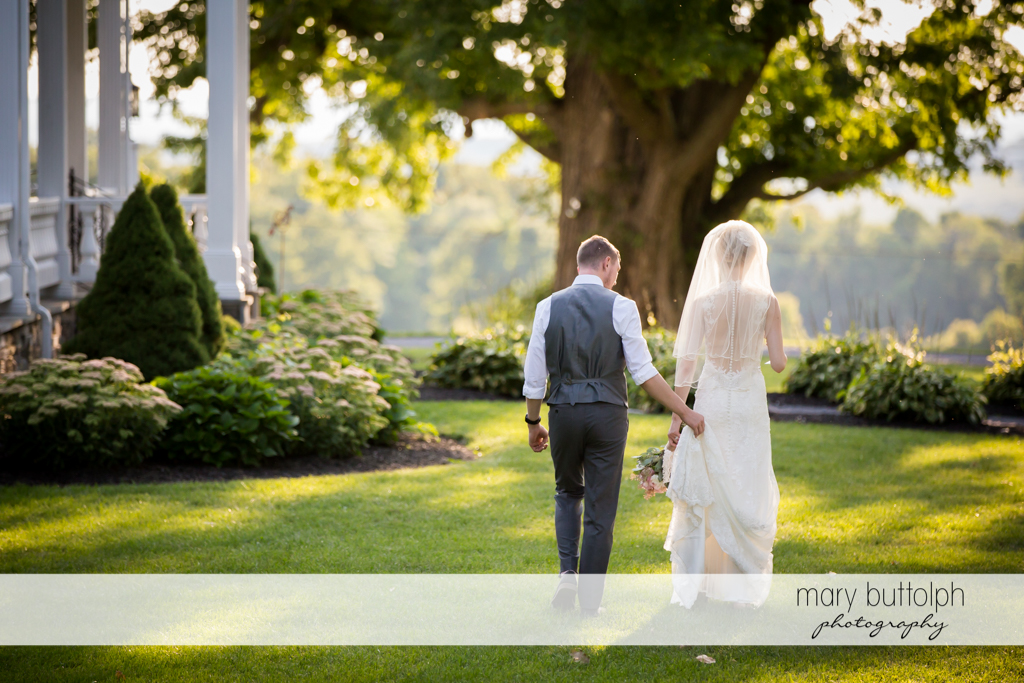 Couple stroll in the garden at John Joseph Inn and Elizabeth Restaurant Wedding