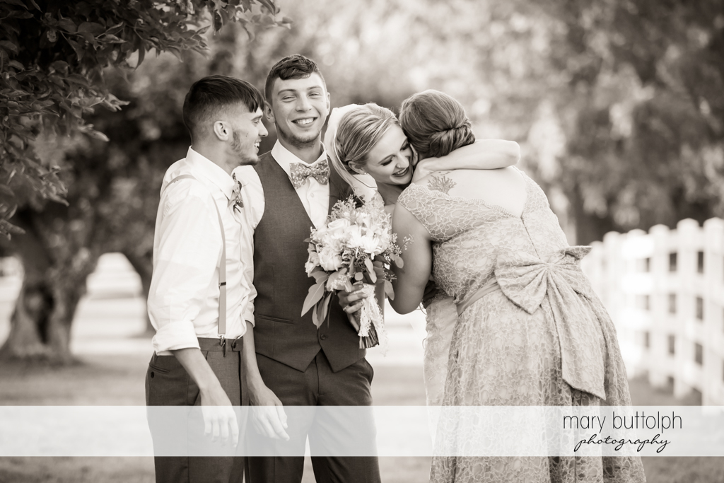 Couple meet friends in the garden at John Joseph Inn and Elizabeth Restaurant Wedding