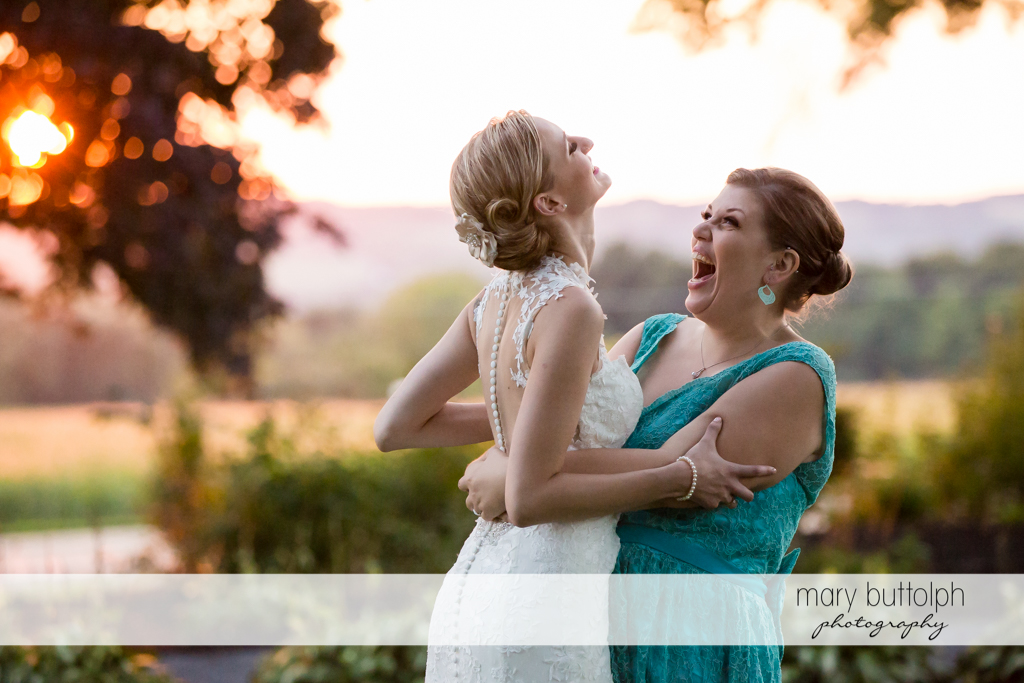 Bride and guest share a laugh at John Joseph Inn and Elizabeth Restaurant Wedding