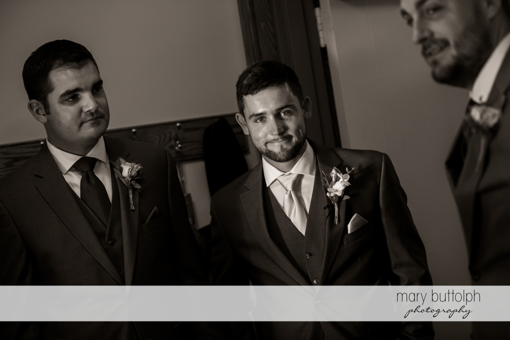 The groom is flanked by the groomsmen at The Lodge at Welch Allyn Wedding