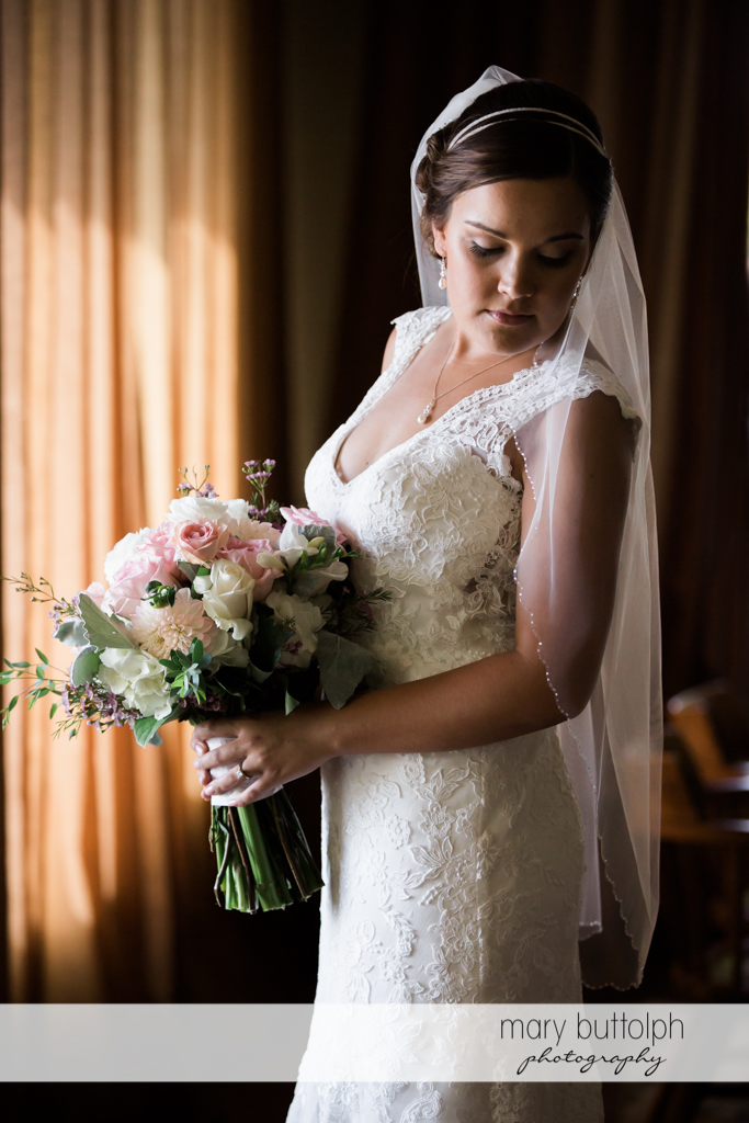 Bride holding flowers at The Lodge at Welch Allyn Wedding