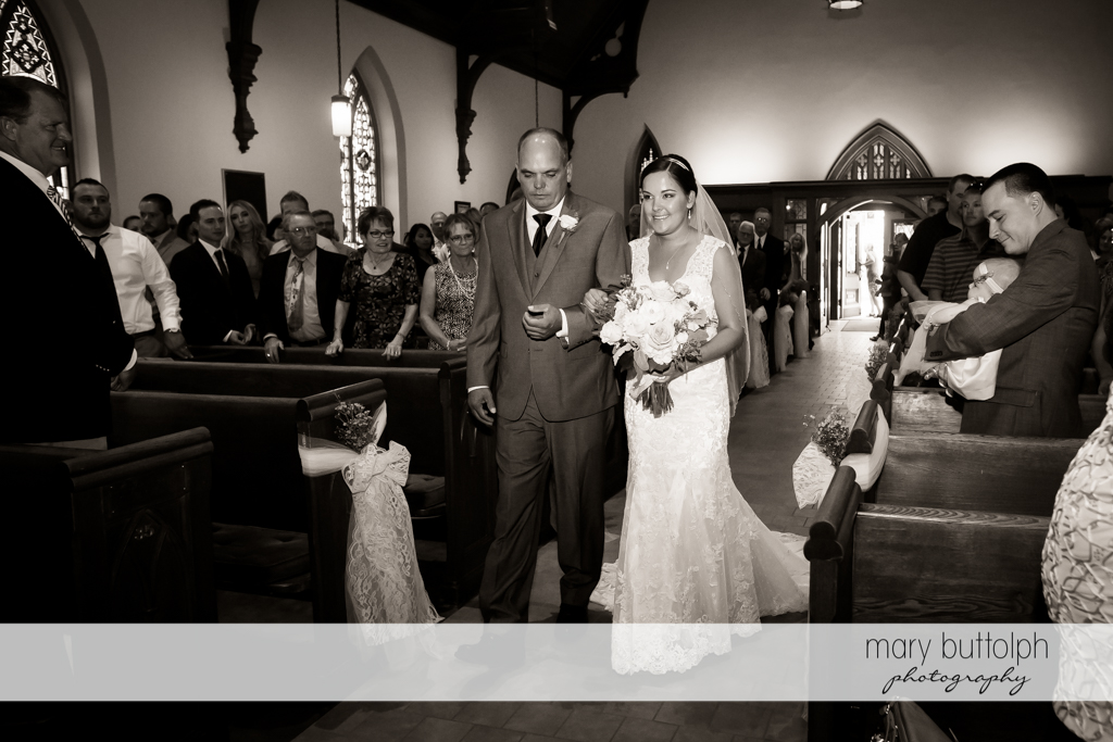 Bride and her father walk down the aisle at The Lodge at Welch Allyn Wedding