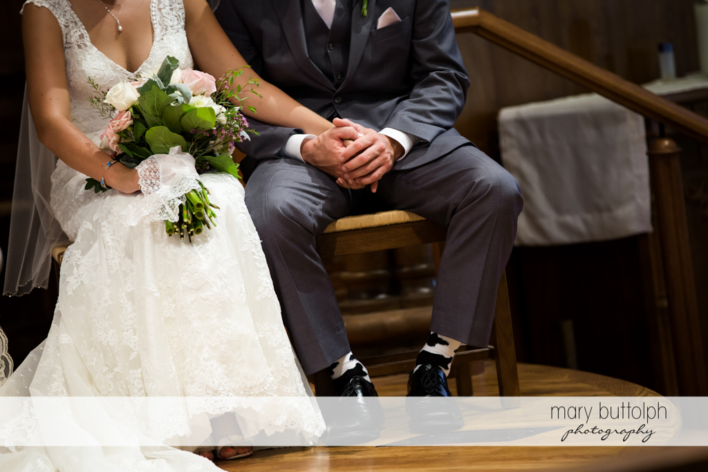 Couple hold hands during the wedding ceremony at The Lodge at Welch Allyn Wedding
