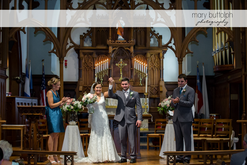 Couple after the wedding ceremony with the bridesmaid and best man at The Lodge at Welch Allyn Wedding