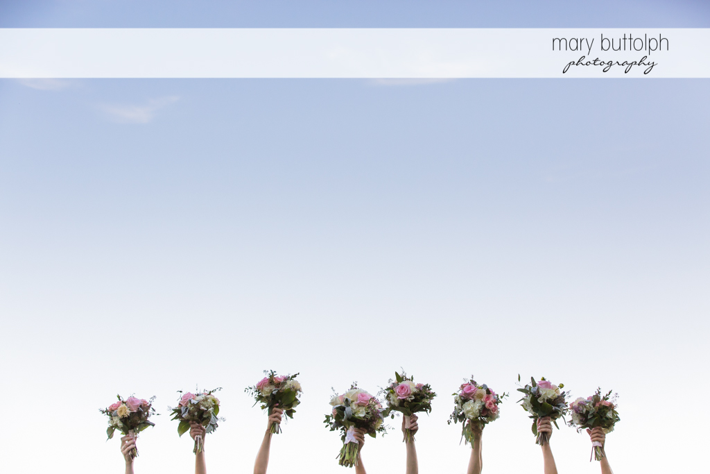Wedding bouquets are raised at The Lodge at Welch Allyn Wedding
