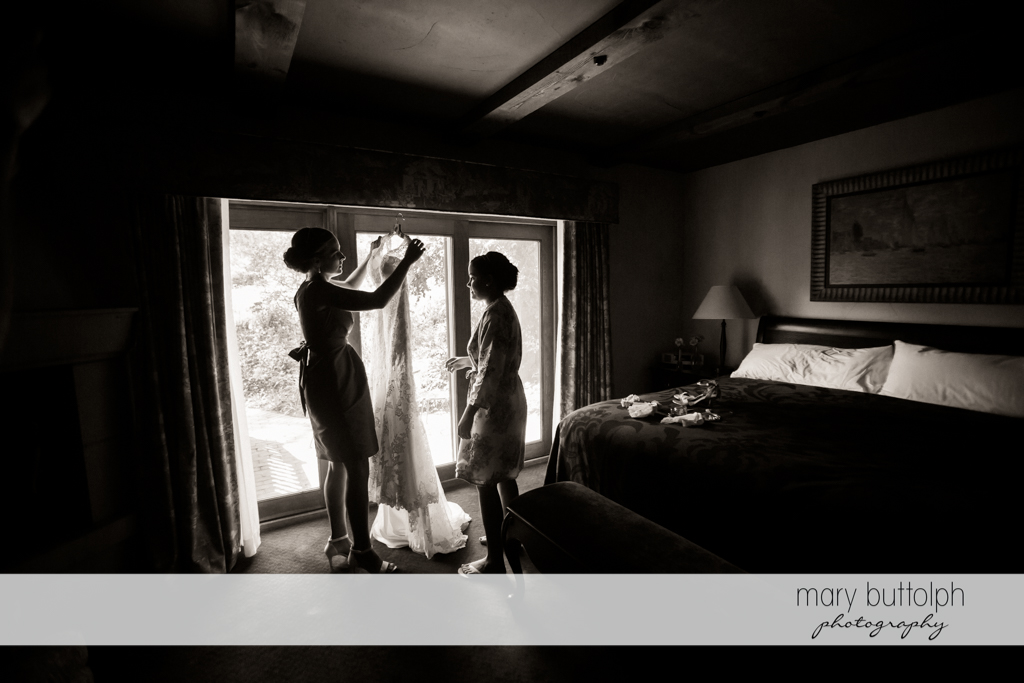 Bride prepares to wear her wedding dress at The Lodge at Welch Allyn Wedding