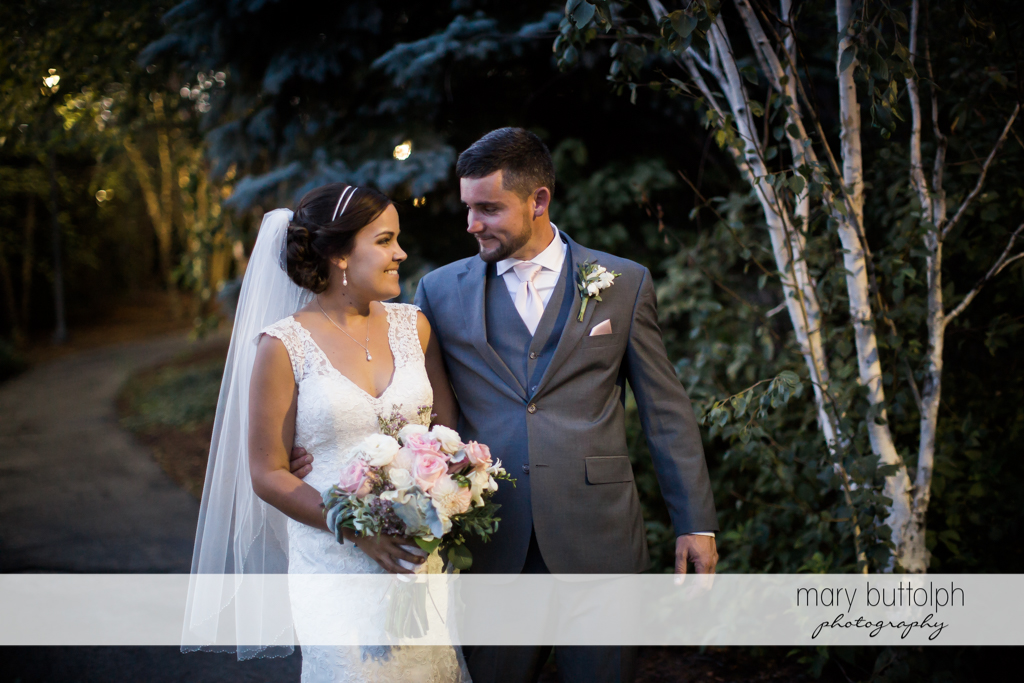 Couple take a quiet stroll after the wedding at The Lodge at Welch Allyn Wedding