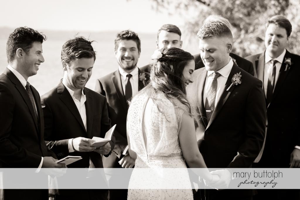 Couple in front of groomsmen at Aurora Inn Wedding