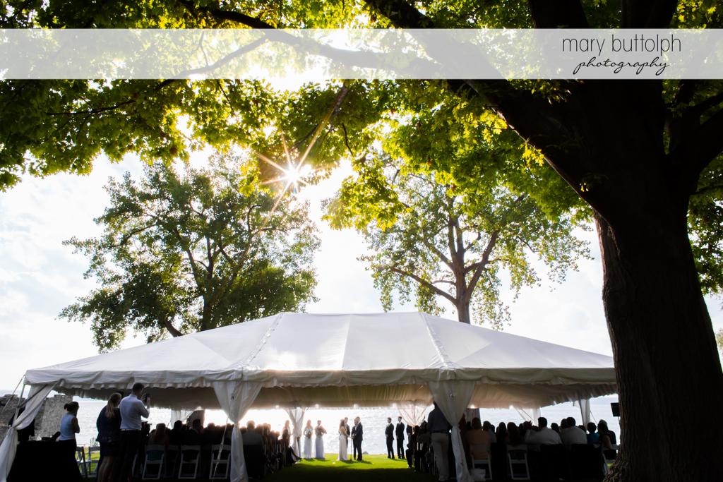 Couple under the wedding tent at Aurora Inn Wedding
