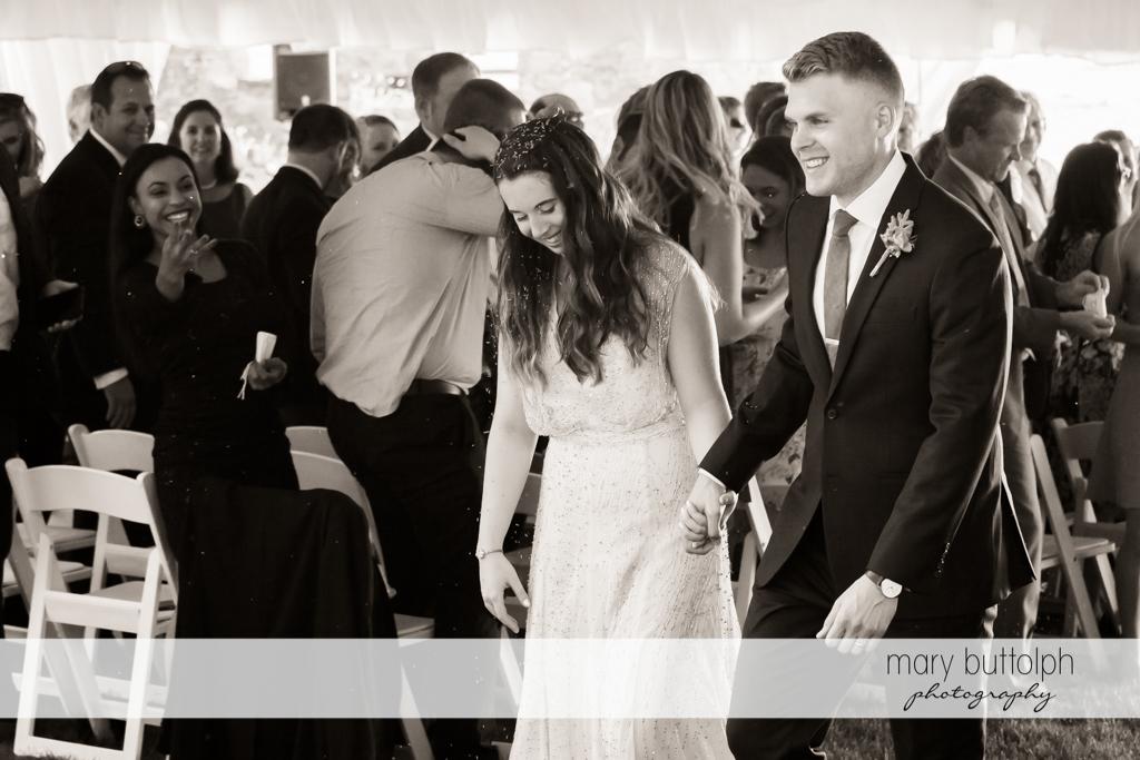 Couple walk down the aisle at Aurora Inn Wedding