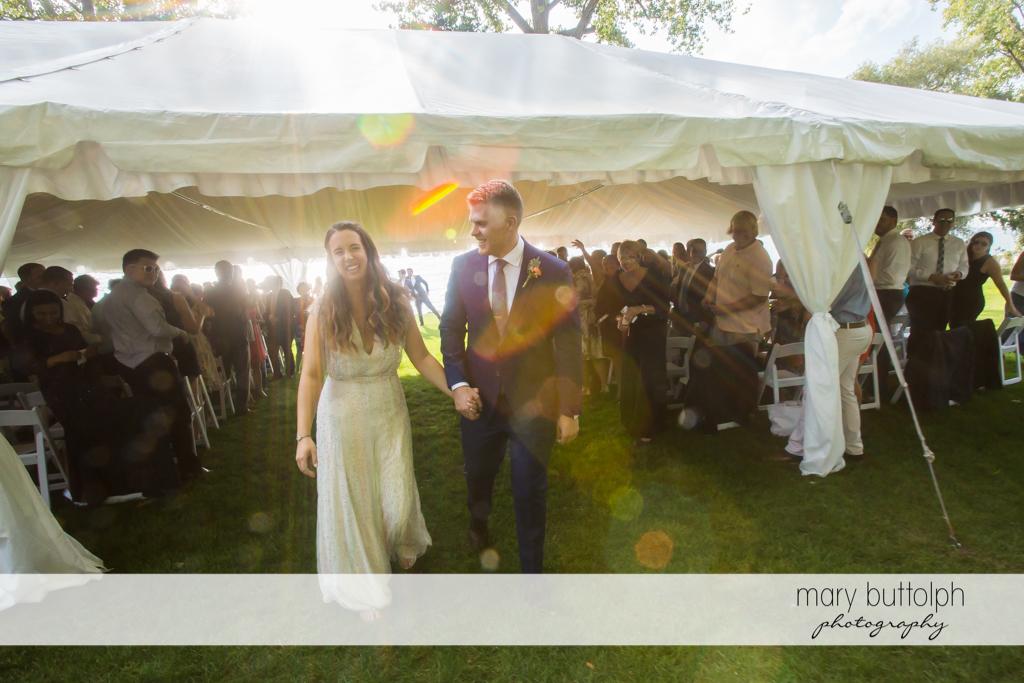 Couple take a walk after the wedding ceremony at Aurora Inn Wedding