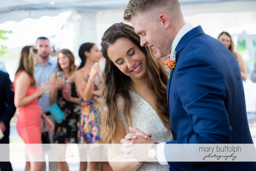 Couple dance in front of guests at Aurora Inn Wedding