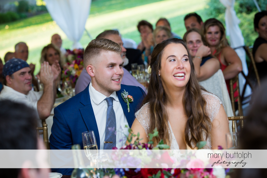 Couple having a good time with guests at Aurora Inn Wedding