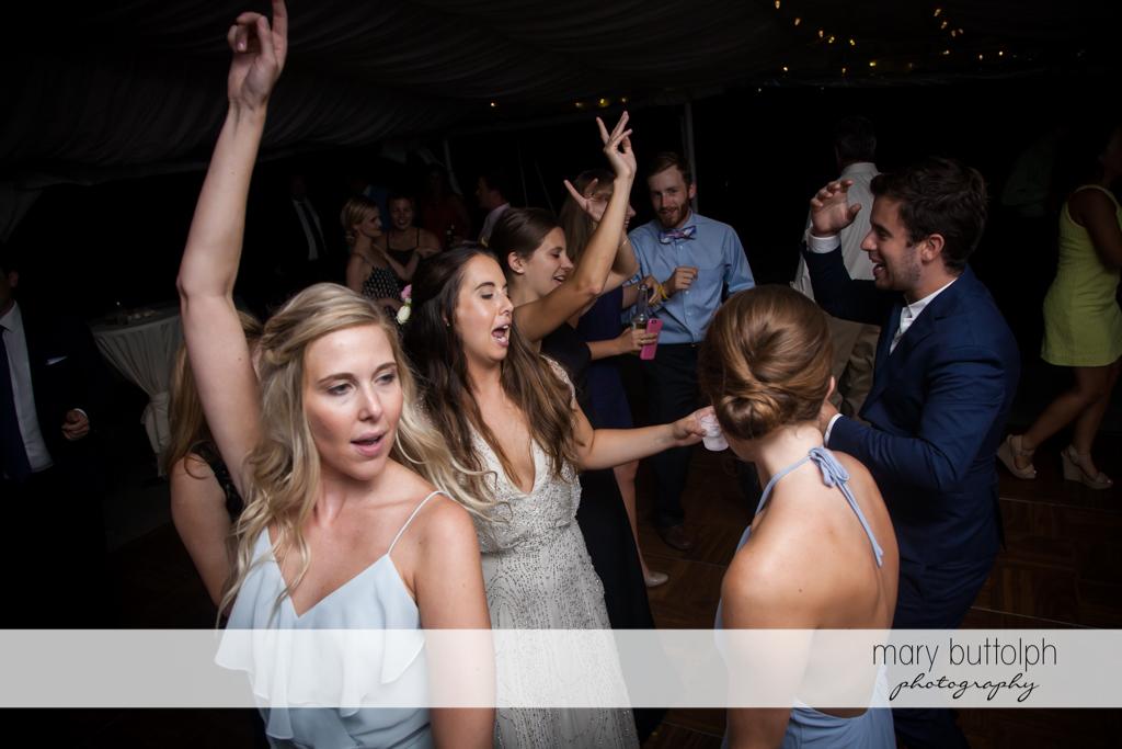 Bride dances with guests at Aurora Inn Wedding