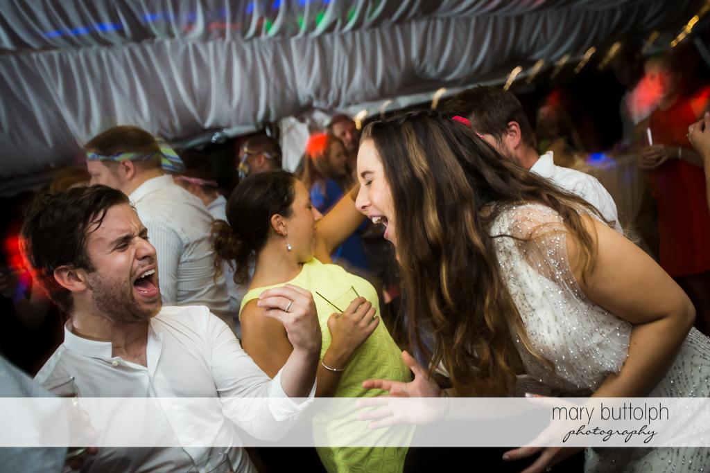 Bride dances with a friend at Aurora Inn Wedding
