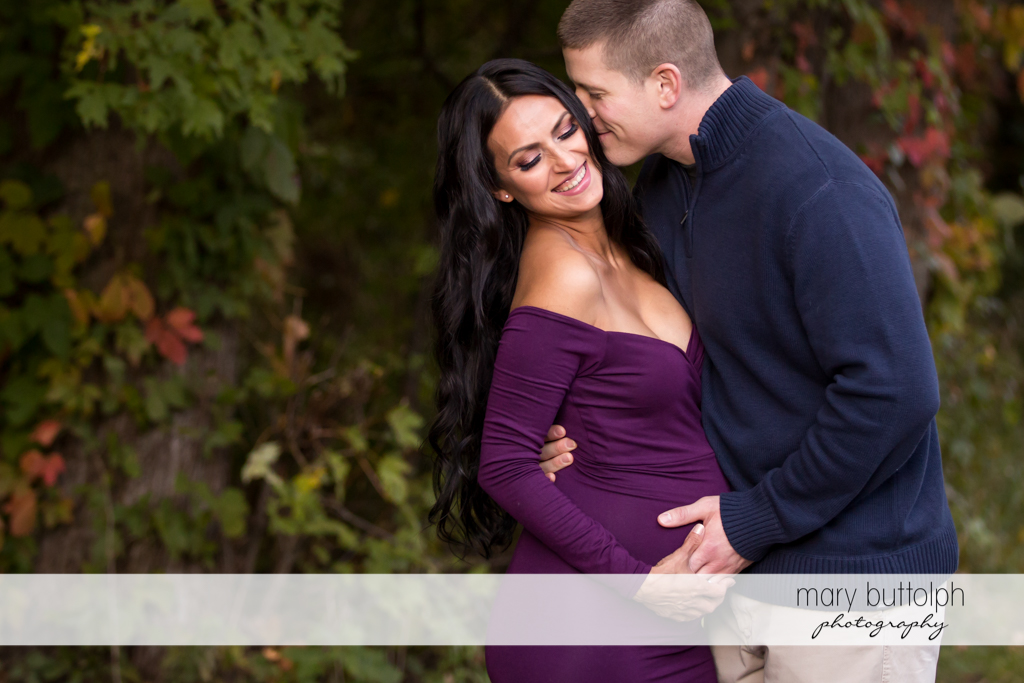 Couple in the garden are thrilled at their new baby at Skaneateles Maternity Photography