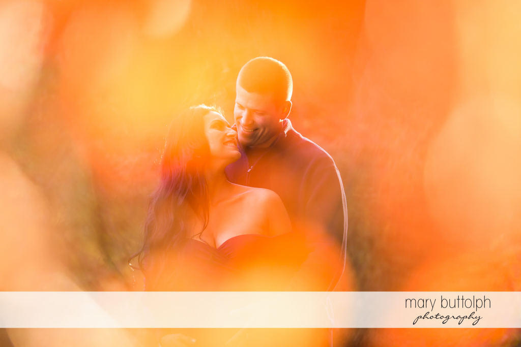 Filtered shot of couple in the garden at Skaneateles Maternity Photography