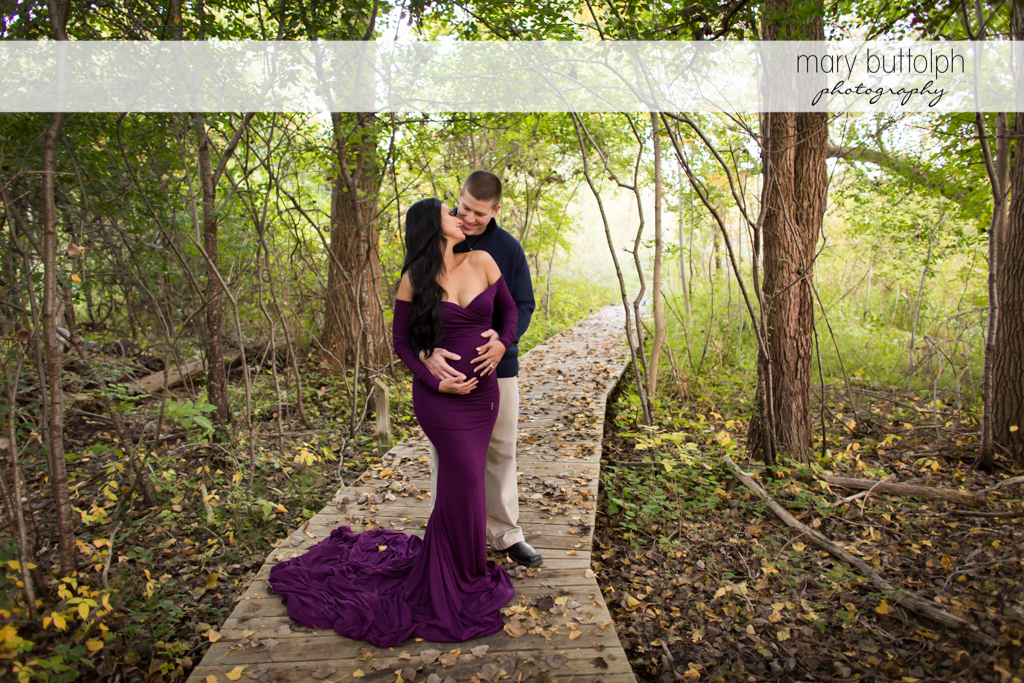Couple pose in the woods at Skaneateles Maternity Photography