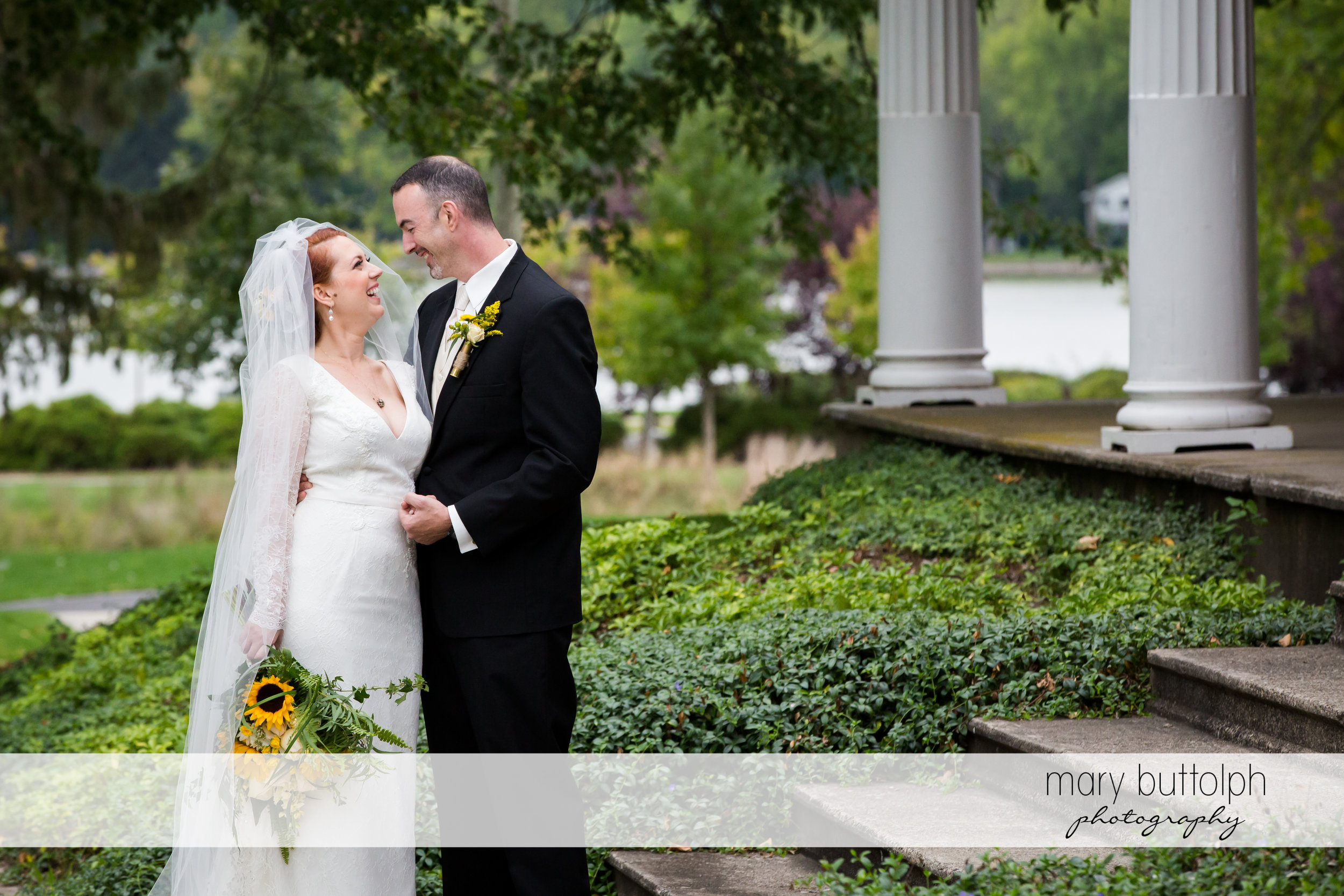 Couple pose in front of the wedding venue at Emerson Park Pavilion Wedding