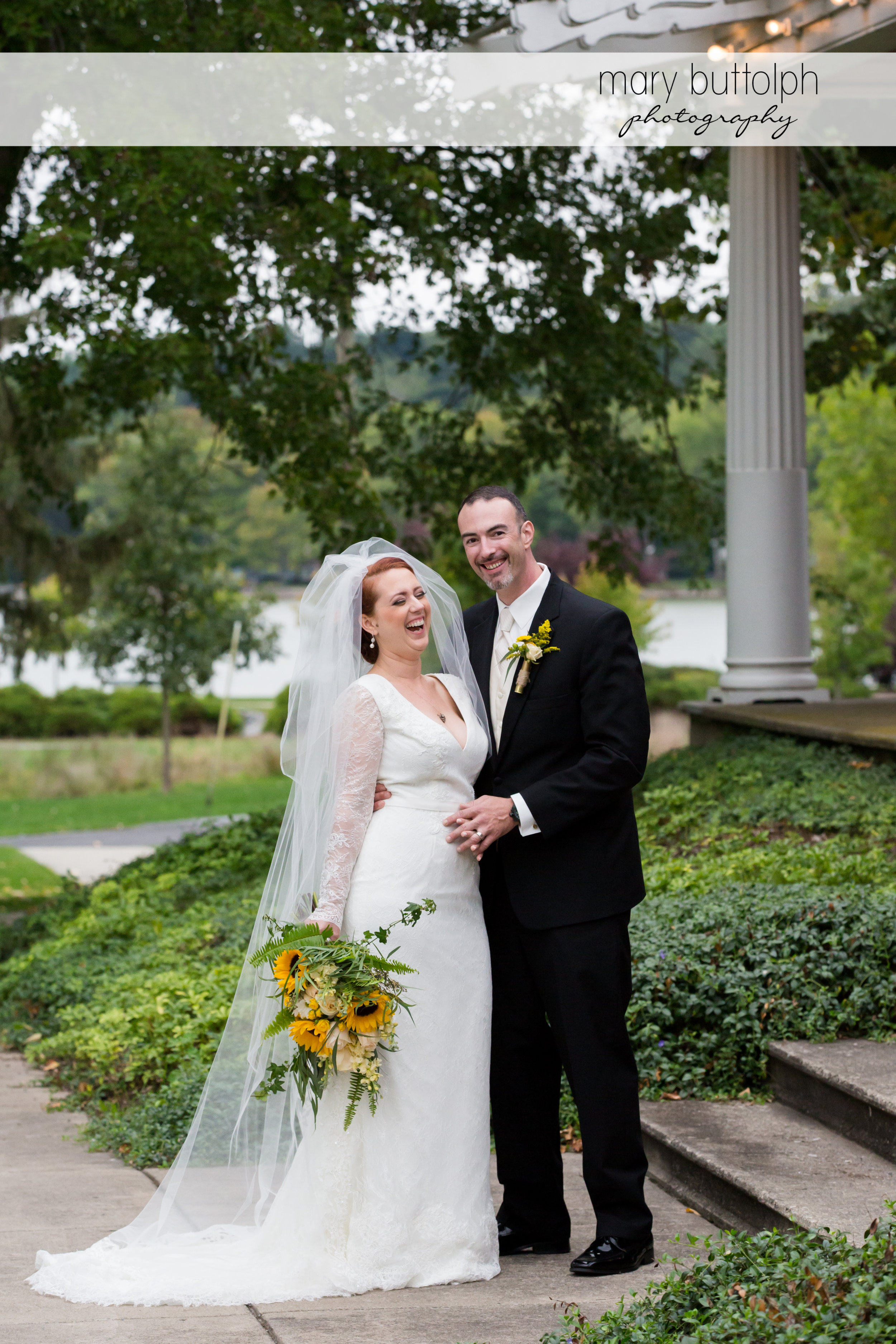 Couple share a light moment in the garden at Emerson Park Pavilion Wedding