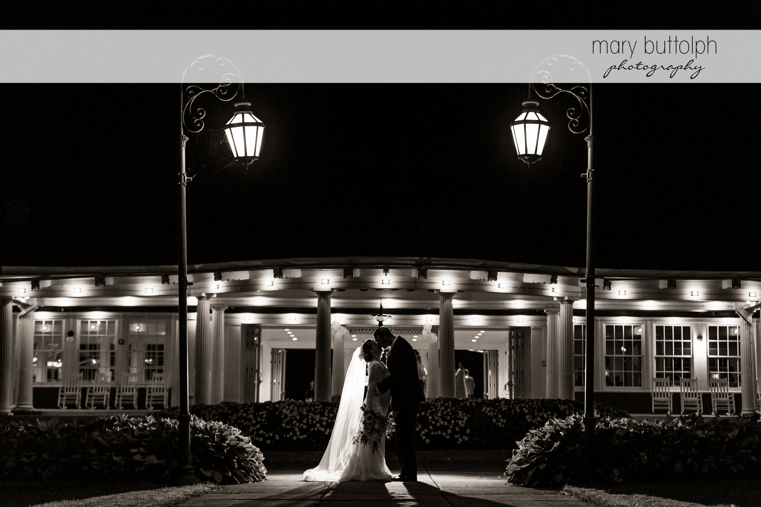 The couple in a dramatic black and white shot outside the wedding venue at Emerson Park Pavilion Wedding