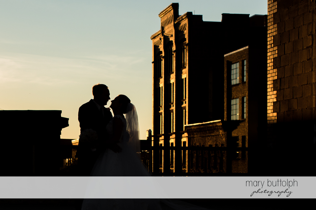 Couple catch the last rays on the sun at SKY Armory Wedding