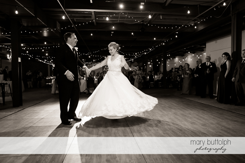 Couple dance as guests look on at SKY Armory Wedding