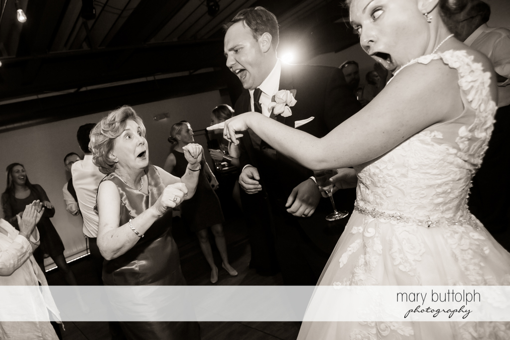 Couple have fun with one of the guests at SKY Armory Wedding