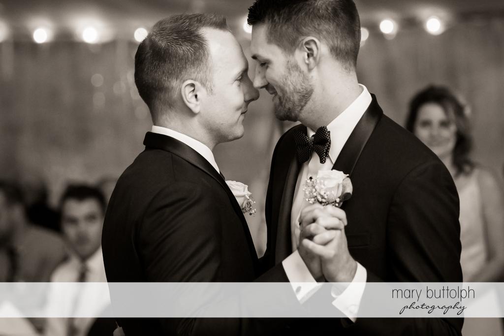 Same sex couple dance after the wedding at Anyela's Vineyards Wedding