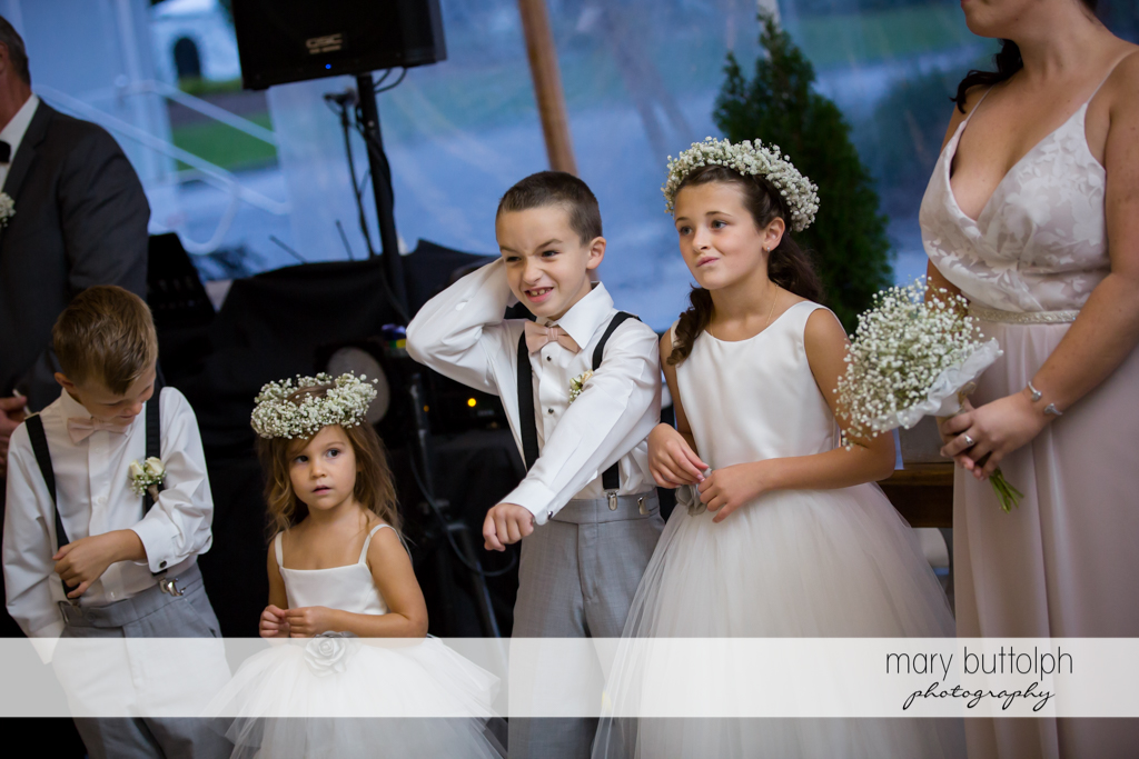 Young members of the wedding party celebrate with same sex couple at Anyela's Vineyards Wedding