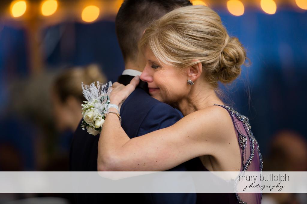 Groom's mother cries while dancing at Anyela's Vineyards Wedding