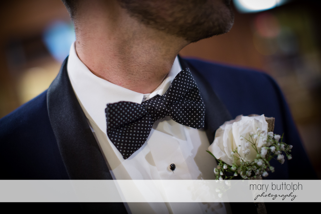 Groom's boutonniere is perfect for his tie at Anyela's Vineyards Wedding