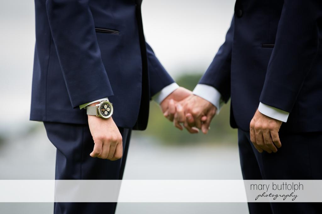 Same sex couple holding hands at Anyela's Vineyards Wedding