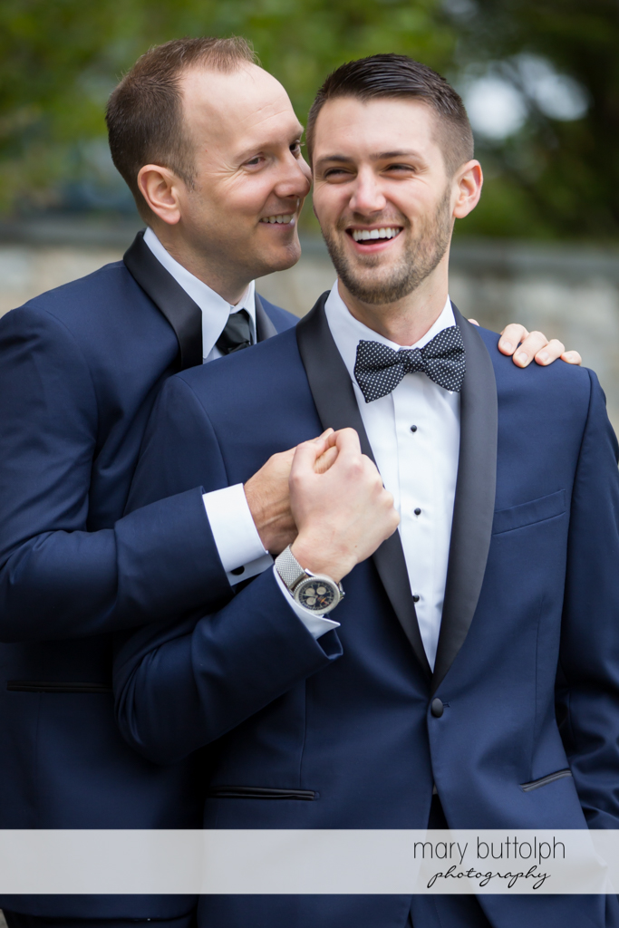Same sex couple share a light moment at Anyela's Vineyards Wedding