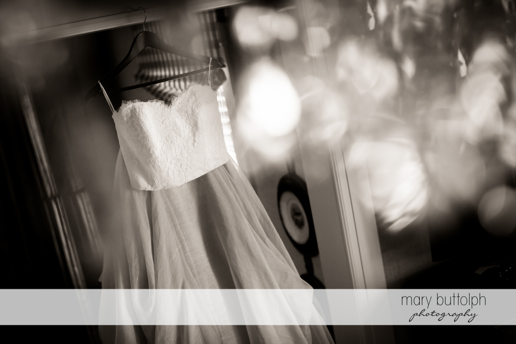 Bride's wedding dress hanging up at Sherwood Inn Wedding