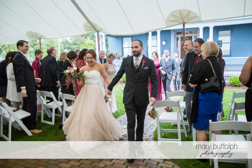 Bride and groom walk the aisle at Sherwood Inn Wedding