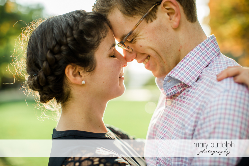 Couple share intimate moment at Cornell University Engagement