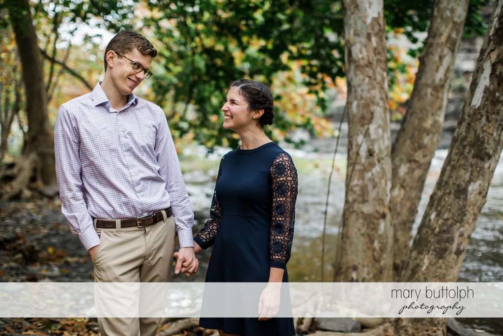 Couple face each other at Cornell University Engagement