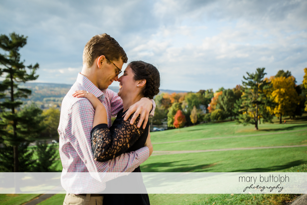 Couple rub noses at Cornell University Engagement