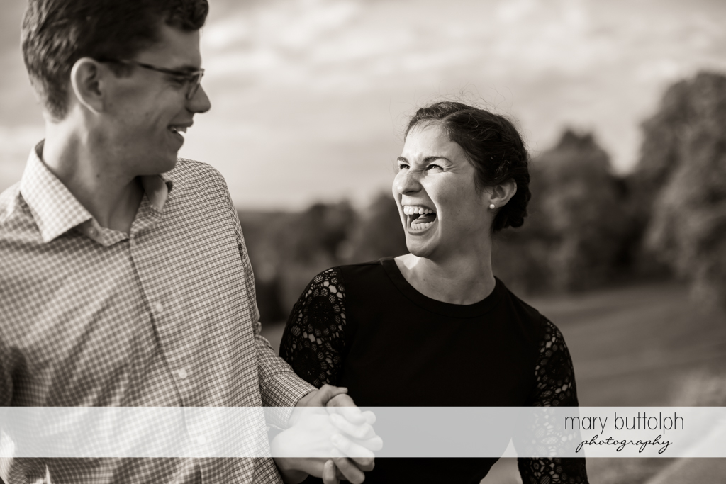 Couple burst into laughter at Cornell University Engagement
