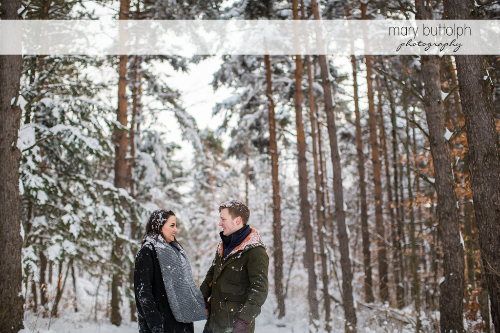 Couple face each other at Highland Forest Engagement