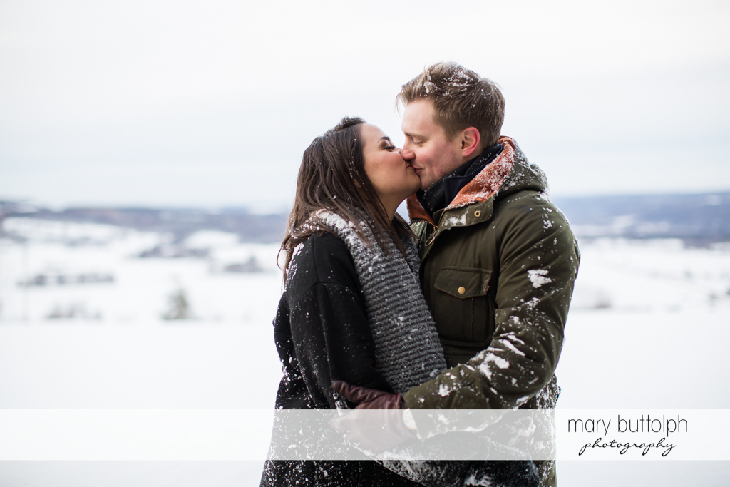 Couple kiss at Highland Forest Engagement