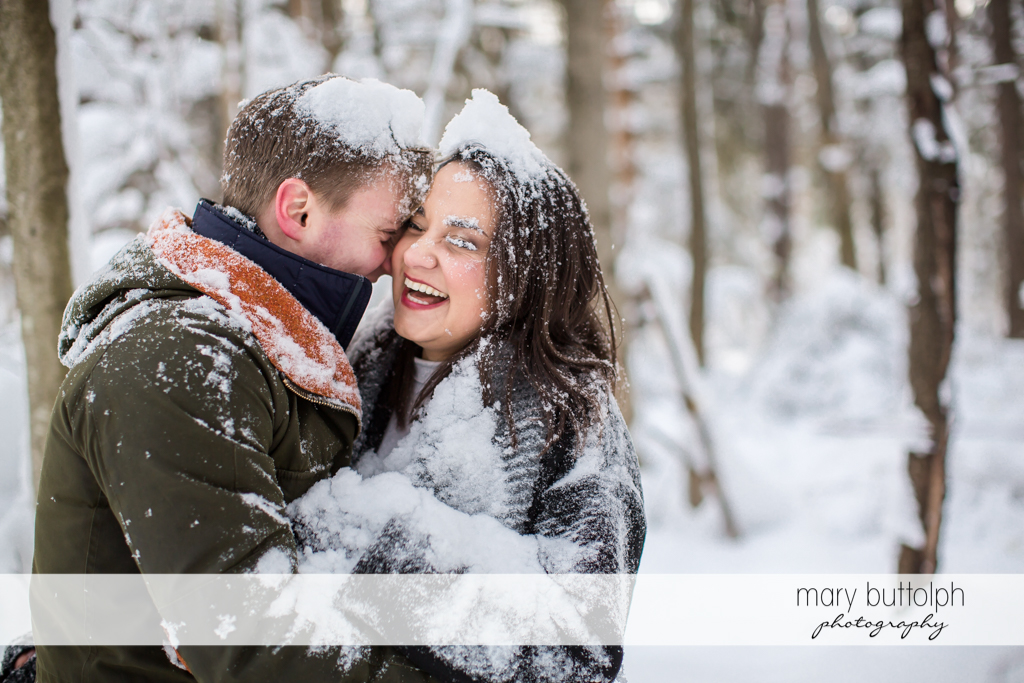 Couple keep warm in Highland Forest Engagement