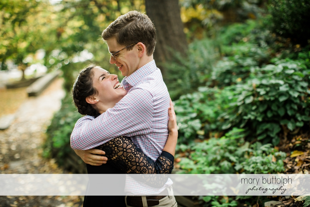 Couple embrace at Cornell University Engagement