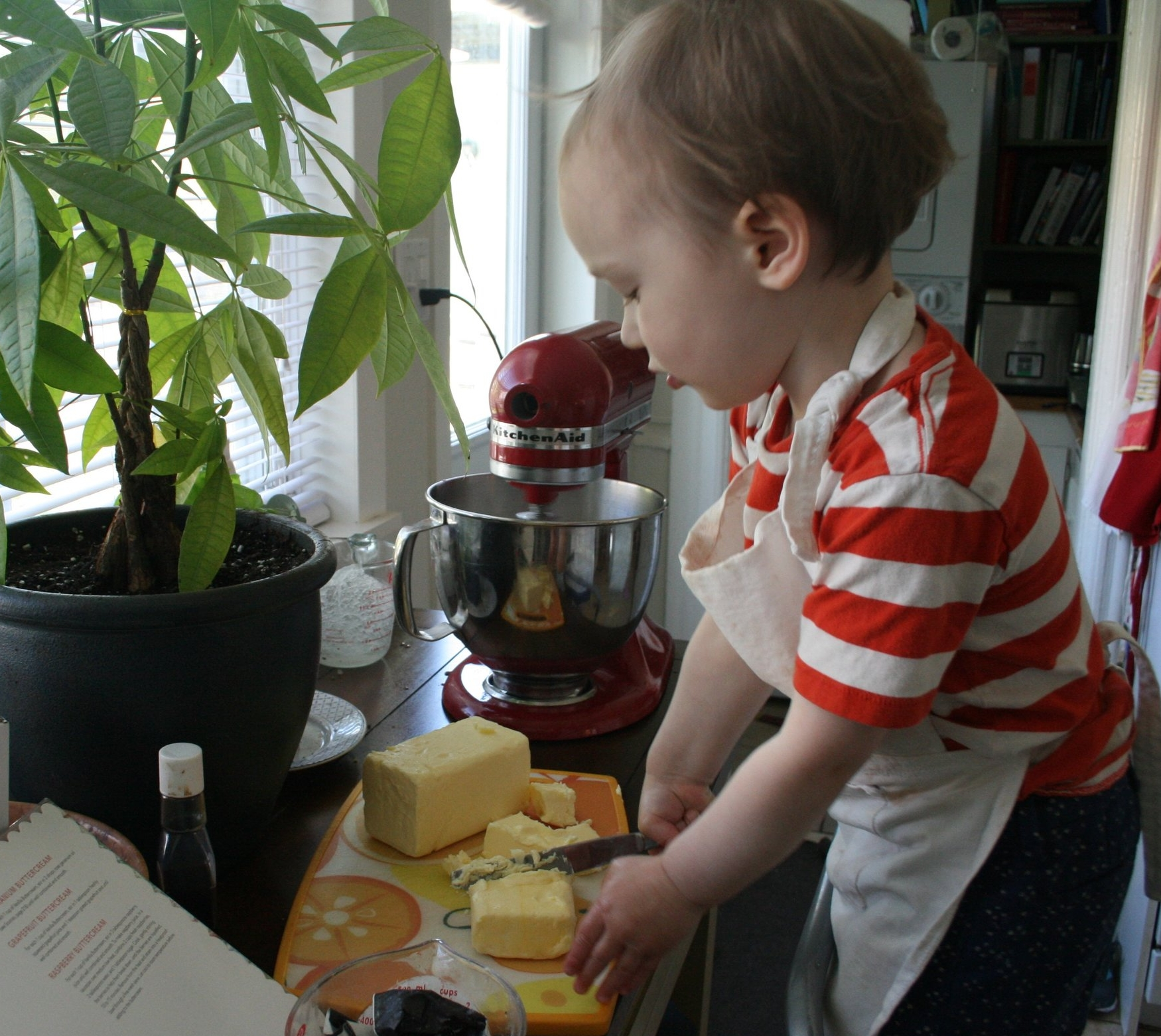 Almost-3-year-old Cash cutting the butter for his buttercream. Yes, all the butter you see goes in the recipe!
